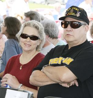 Glenna and Robert Henry of Williamstown wait for the ceremony to begin. He is a retired Cincinnati police officer and an Army veteran Purple Heart recipient.