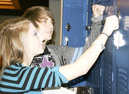 Jena Schuller, a freshman, gets help with her locker at Grant County High School from Logan Mallicoat, a senior.