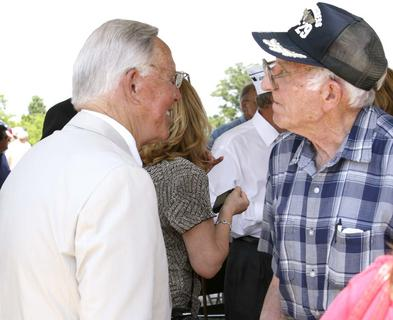 Ken Lucas, commissioner for veterans affairs, talks with WWII veteran Hubert Lusby. Lucas is a 1950 graduate of Dry Ridge High School.
