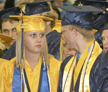 Valedictorian Haley Mullins and Salutatorian Michael Schultz share a serious moment.