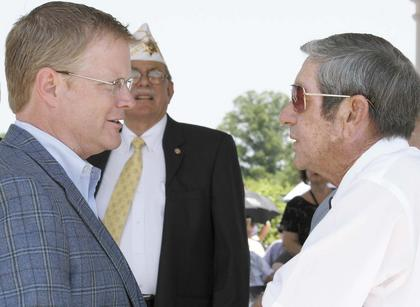 State Sen. Damon Thayer talks with Dry Ridge Mayor Clay Crupper.