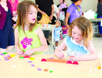 Annabelle and Willow Stacey build a structure with blocks at the 2019 Early Childhood Fair held May 18 at the Grant County Public Library. The free event was designed for parents/guardians with children from birth to 5 years old. There were local school representatives to answer school-related questions, as well as games and activities for children in attendance. Photos by Mark Verbeck