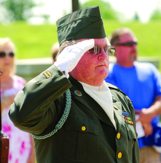 Grant County Veterans Honor Guard Butch Barlow member salutes. Barlow was last year's Veteran of the Year.