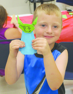 Brody McComas shows off his Origami Yoda.