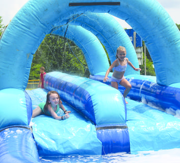 SPLISH SPLASH - Cassidee Jackson and Briley Good race down the slide into water July 15 at Grant County Park in Crittenden. Photos by Samantha Tamplin