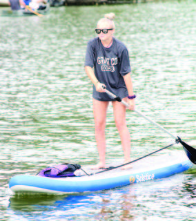 Cecilia Reed keeps her balance on her stand-up paddleboard.