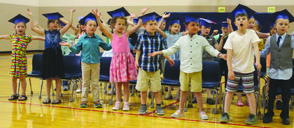 Sherman Elementary kindergartners dance to a song during the promotion ceremony, officially starting off their transition to first grade. Photos by Samantha Tamplin