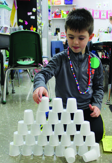 DRE student Cole Turner stacks 100 cups.