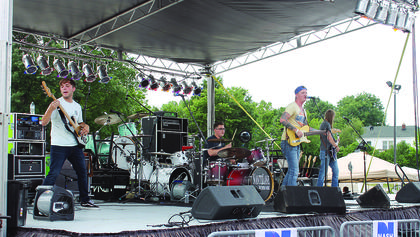 Northern Kentucky-based band, Comfortably Broke, perfoms another round of country songs during the afternoon at Rockin' the Ridge.