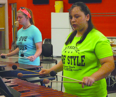 Haley Horrigan and Cristina Tolle play percussion.