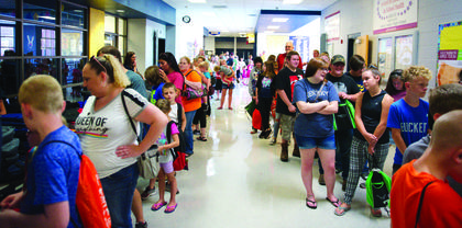 Member of the community lined up for free backpacks and supplies. The event took place Aug. 10 at Grant County High School and was open to students from Grant, Williamstown and homeschooled students in the area. Photos by Mark Verbeck