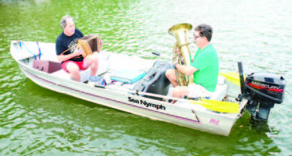 Dan Stoutenborough and Hans Schreyer play instruments on Aug. 25 at the annual Paddle Williamstown held on Williamstown Lake.