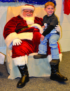 CMZ's David Cecil smiles for another camera after telling Santa he was good all year and deserves gifts.