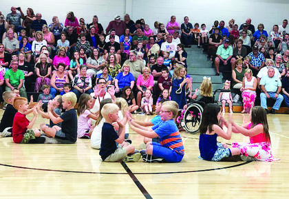 Dry Ridge Elementary students demonstrate a musical performance for their grandparents. Photo submitted