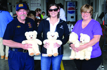 Dry Ridge Fire Chief Rodney Smith, Megan Cordray with Shriners Hospital and Dry Ridge Elementary FRC Marianne Smith prepared to package the bears to send to Shriners Hospital. Photos by Jerry Morris