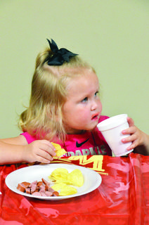 Raelyn Jones takes a break at snack time during Knoxville Baptist's VBS held on June 17 through June 21.  Photos by Jerry Morris