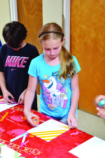 Shaylynn Hess participates in arts and crafts.