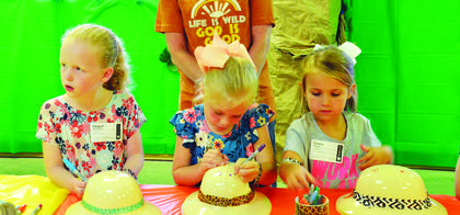 Abigail Sturdivant, Paisley Hearn and Emery Holland decorate their hats. Photos by Jerry Morris