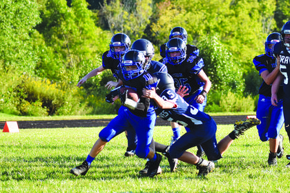 Matthew Hall tackles an opposing player. The seventh grade Braves team lost 44-0 to Royal Springs.