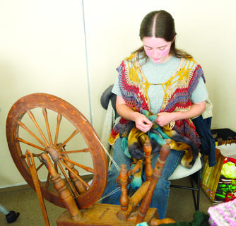 Alysha Gaskill spins yarn at the Yarnival held at Grant County Public Library on April 27.  There were vendor marketplace, activities for kids, door prizes and workshops. Photos by Mark Verbeck