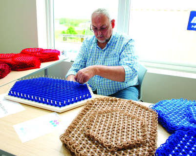 James Conley of Dry Ridge weaves placemats.