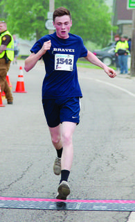 William Powers keeps up the pace in the Derby Dash 5K.