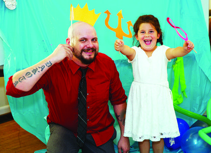 Robert and Makiya Branch play with the photo props at the father-daughter dance that was held on Sept. 8 at the American Legion Hall in Williamstown. Photos by Mark Verbeck