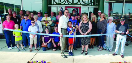 Operation Honor Founder Joe Montgomery cuts the ribbon during the grand opening of Patriots Landings' temporary home in Dry Ridge on May 25. Photos by Mark Verbeck