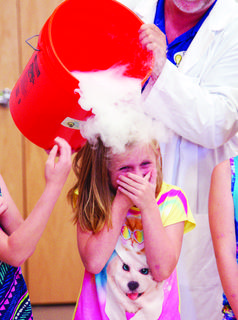 Kylie Fannon giggles as a science experiment is poured over her head.