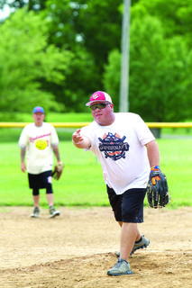 Jeff Perkins pitches the softball. Photos by Mark Verbeck