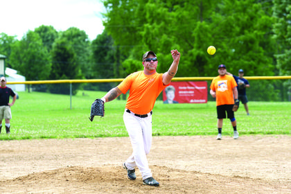Chris Miller throws a pitch to a batter during the GC Little League coaches game.