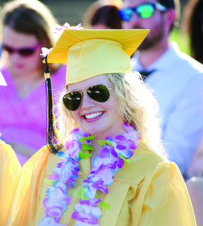Rachel Williams enjoys the sunny evening at GCHS graduation with a floral necklace and sunglasses.