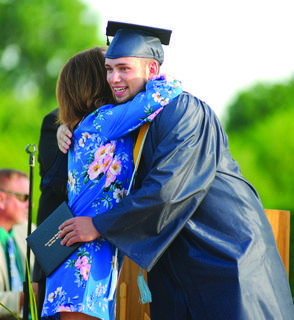 Michael Frost hugs Principal Linda Foxx after receiving his diploma at GCHS graduation May 25.