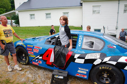 Justin Vance grabs a look inside of the race car from Kentucky Raceway Ministries.