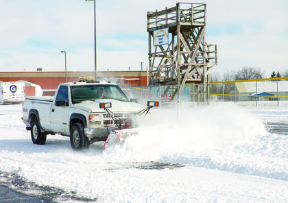 GCHS student Alex Brockman plows the parking lot at the high school. Photos by Mark Verbeck