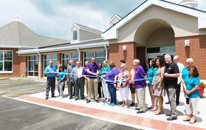 Grant County Public Library staff and members of the Grant County Chamber of Commerce cut the ribbon at the grand re-opening of the library.