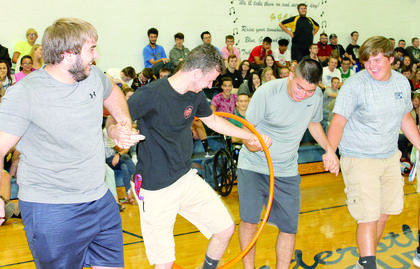 GCHS students Reagan Patrick, Steven Cummins, Lorenzo Baumgardner and Logen Bingaman participate in a class relay during a first-day pep rally. Photos by Camille McClanahan, Bryan Marshall and Amanda Kelly