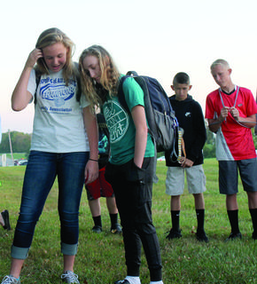 Emily Naranjo and Cecilia Gay step forward in the center of the prayer circle at GCMS See You at the Pole event Sept. 27.