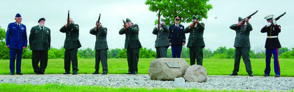 The Grant County Veterans Honor Guard participates in a 21-gun salute during the Memorial Day event.