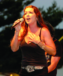 ROCKIN' THE RIDGE - Headliner Gretchen Wilson performs for the crowd while spectators rock out to the music.