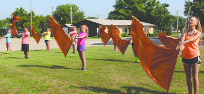 Members of the Williamstown color guard practice their form.