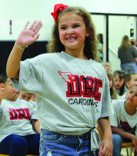 Hailey Burke waves to her family in the crowd.