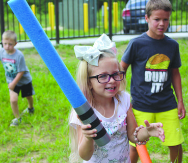 Hunter Brockman tries out her lightsaber. Photos by Samantha Tamplin