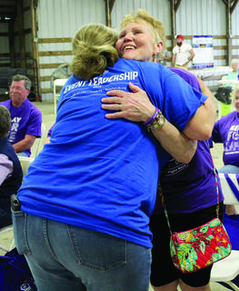 Donna Blackburn receives a hug after getting her survivor medal. Photos by Amanda Kelly