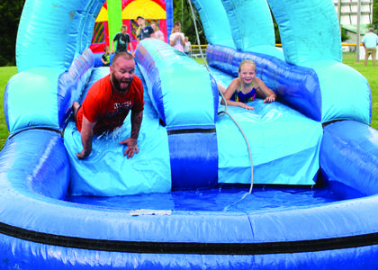 Donnie Loper and Alvera Scott race to the end of the slide.  Photos by Amanda Kelly