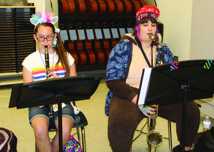 Kahlan Rudy and Ava Herrmann work on memorizing the notes on their clarinets.