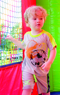 Carter Jackson jumps in the bouncy house.