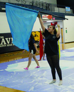 Charlesey Webster spins her flag around during color guard practice.