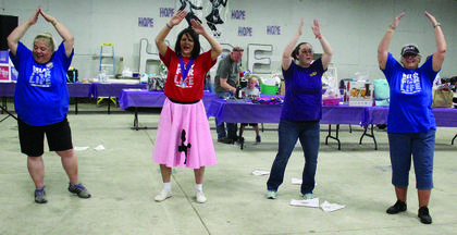 "Jamie Baker, Sheila Carr, Nicole Fields and Amy Edmondson dance like no one was watching to ""YMCA."""