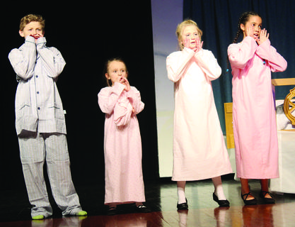"Alan Price (Kurt), Sandra Voelker (Gretl), Ella Miller (Marta) and Rosebella Fox (Brigitta) sing aloud during a scene. Performances of ""The Sound of Music"" are 7 p.m. April 26-27 and 2 p.m. April 28 at Grant County High School. Tickets are $8. Photos by Amanda Kelly"